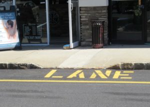 Curb ramp with steep side slopes
